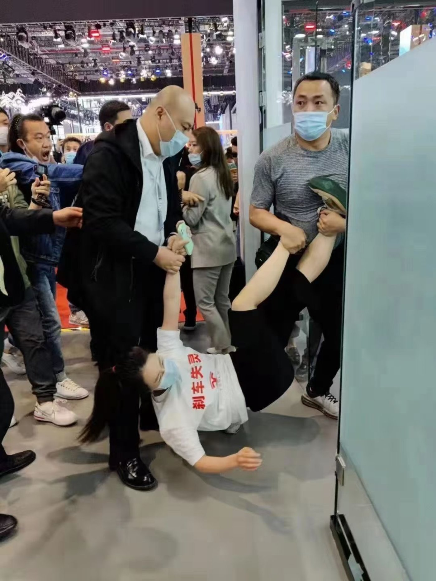 a protester was dragged away
